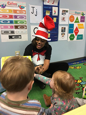 Teacher reading to preschool students