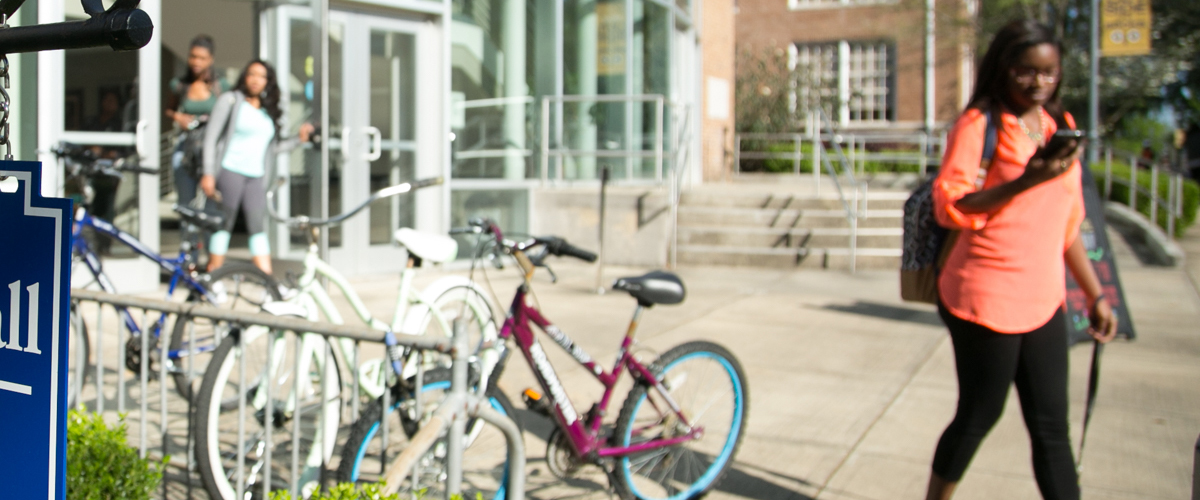 students walking and bicycles in a rack