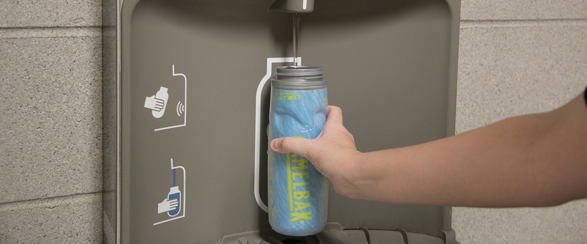 filling a water bottle in the water fountain