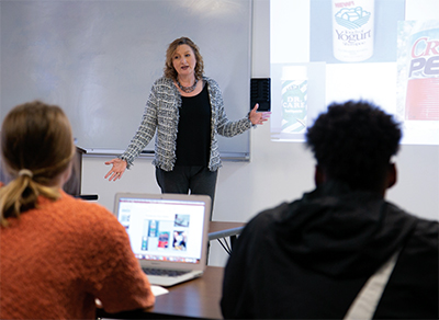 Dr. Larson lectures business students