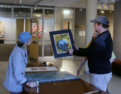 Students select art for auction